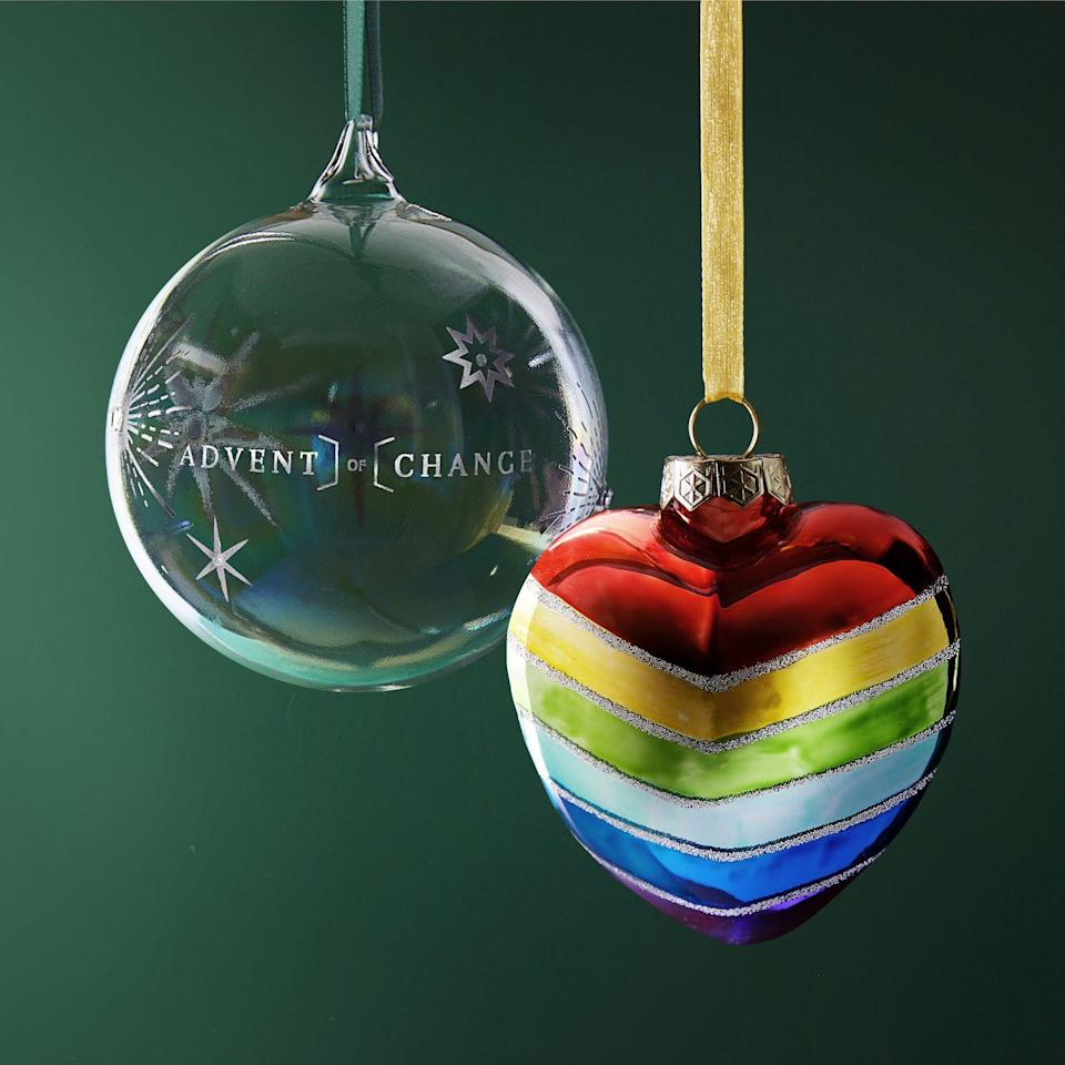 <p>Give back this Christmas with these charity baubles.</p><p>The Advent of Change charity tree decoration (left) is an iridescent bauble featuring a subtle embellished star design with 10 distinctive shapes. Each one represents a charity supported by the purchase (the corresponding charity can be found on the box). </p><p>The Charity Heart Rainbow Bauble (right) features a bright rainbow heart, the symbol of support for NHS workers. 25 per cent from the sale of this bauble goes to the charity NHS Charities Together supporting NHS staff and volunteers caring for Covid-19 patients.</p>