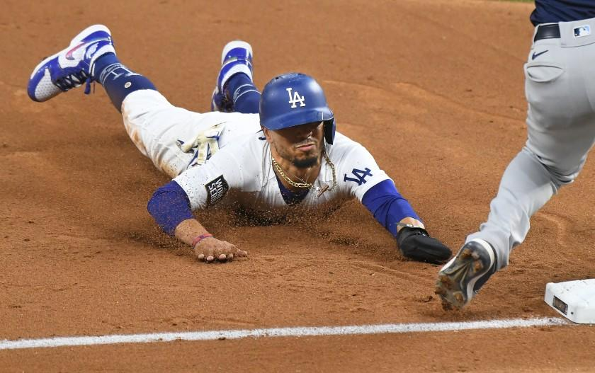 ARLINGTON, TEXAS OCTOBER 20, 2020-Dodgers Mookie Betts steals 3rd base against the Rays in the 5th inning in Game 1 of the World Series at Globe Life Field in Arlington, Texas Tuesday. (Wally Skalij/Los Angeles Times)