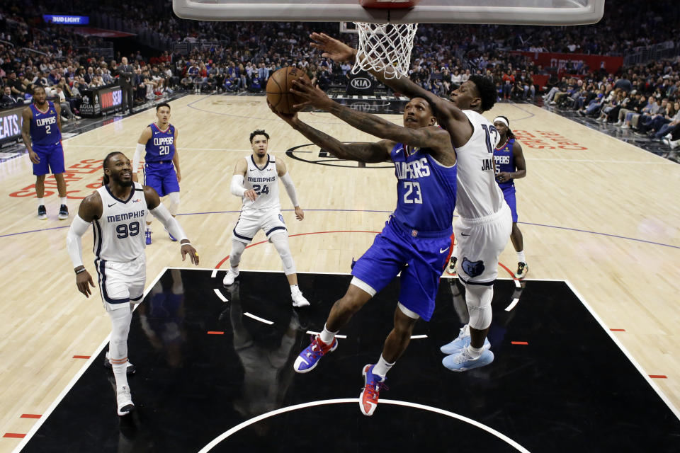 Los Angeles Clippers' Lou Williams (23) drives to the basket as Memphis Grizzlies' Jaren Jackson Jr., right, defends during the second half of an NBA basketball game Saturday, Jan. 4, 2020, in Los Angeles. (AP Photo/Marcio Jose Sanchez)