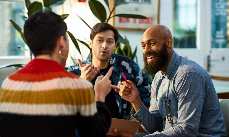Multi ethnic group sharing ideas in office