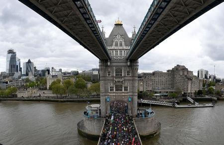 FILE PHOTO: Athletics - London Marathon - London, Britain - April 28, 2019 General view as runners go over Tower Bridge during the London marathon REUTERS/Toby Melville