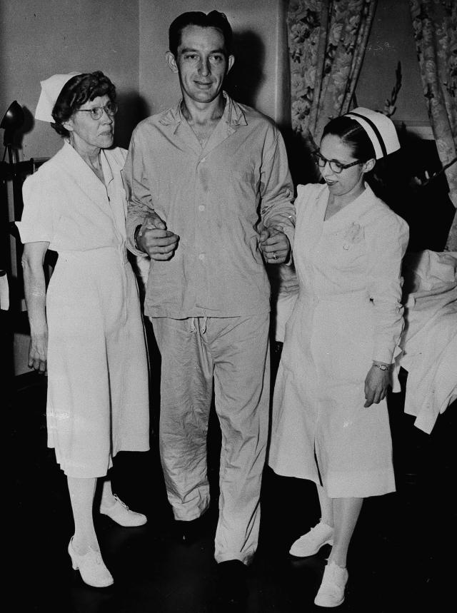 "FILE - In this June 21, 1949 file photo, Philadelphia Phillies first baseman Eddie Waitkus, with help from nurses at Illinois Masonic Hospital in Chicago, takes his first steps since he was shot June 14 in a Chicago hotel by 19-year-old Ruth Steinhagen. Steinhagen died of natural causes at 83 in late December 2012 but her death was not noticed by the media until this week. Her death is the final chapter in one of the most sensational and bizarre criminal cases in Chicago history that made headlines around the country. She was the inspiration for Bernard Malamud's novel ""The Natural"" and the 1984 movie starring Robert Redford. (AP Photo/File)"