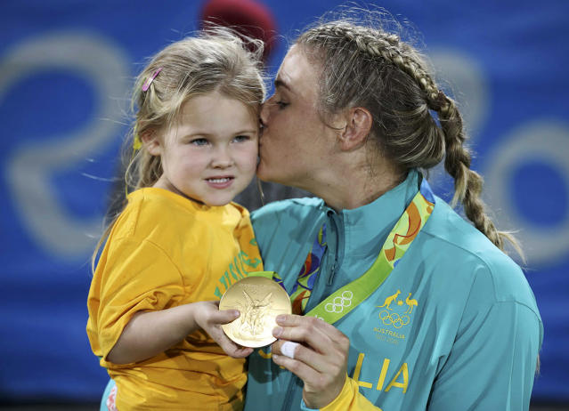 <p>Nicole Beck of Australia celebrates winning her gold medal with her daughter Sophie Willoughby after the medal ceremony for women's rugby on August 8, 2016. (REUTERS/Phil Noble) </p>