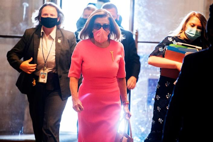 House Speaker Nancy Pelosi, D-Calif., wears a mask at the Capitol during the pandemic. (Tom Williams/CQ Roll Call)