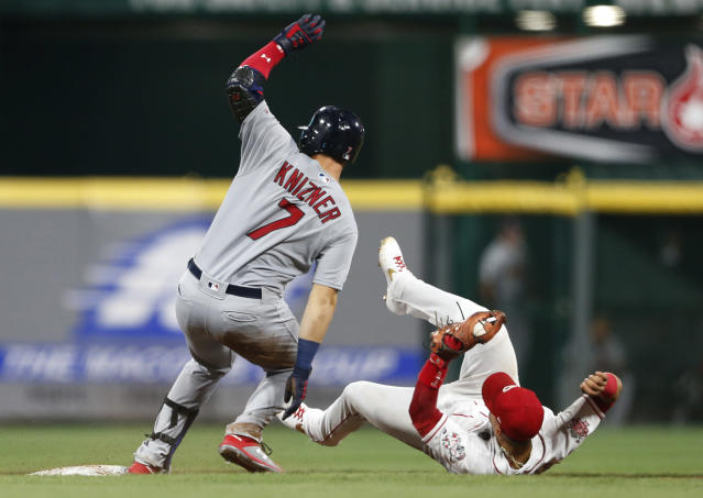 St. Louis Cardinals' Andrew Knizner (7) is safe at second base with a double as Cincinnati Reds second baseman Scooter Gennett falls backward while taking the throw during the sixth inning of a baseball game Friday, July 19, 2019, in Cincinnati. (AP Photo/Gary Landers)