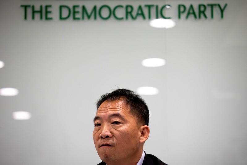 Wu Chi Wai, Chairperson of the Democratic Party attends a news conference after the local district council election in Hong Kong