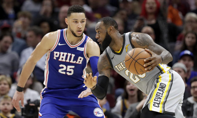 LeBron James and Ben Simmons get acquainted. (AP)