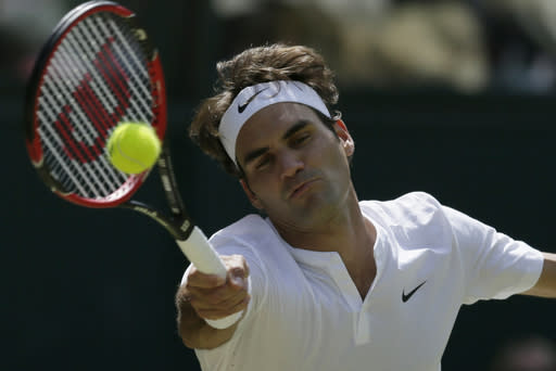 Roger Federer of Switzerland returns to Sam Groth of Australia during their singles match at the All England Lawn Tennis Championships in Wimbledon, London, Saturday July 4, 2015. (AP Photo/Tim Ireland)