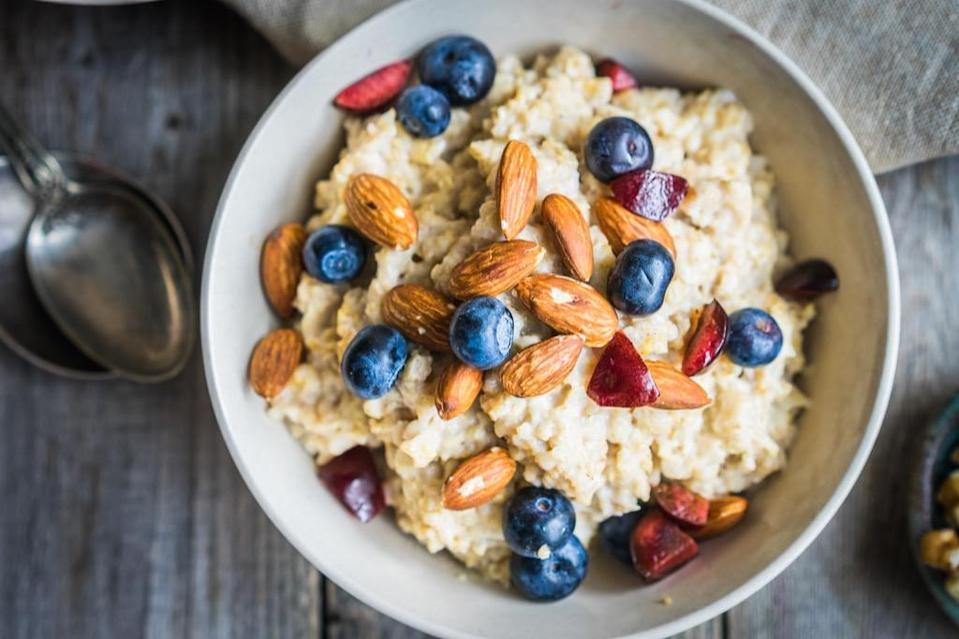 """Oatmeal isn't just cheap and delicious—it's also a great way to improve your health. A 2014 meta-analysis published in the <em>American Journal of Clinical Nutrition</em> revealed that oatmeal can <a href=""""https://academic.oup.com/ajcn/article/100/6/1413/4576477"""" rel=""""nofollow noopener"""" target=""""_blank"""" data-ylk=""""slk:reduce bad cholesterol"""" class=""""link rapid-noclick-resp"""">reduce bad cholesterol</a>, slashing your <a href=""""https://bestlifeonline.com/heart-disease-risk-factors/?utm_source=yahoo-news&utm_medium=feed&utm_campaign=yahoo-feed"""" rel=""""nofollow noopener"""" target=""""_blank"""" data-ylk=""""slk:risk of heart disease"""" class=""""link rapid-noclick-resp"""">risk of heart disease</a> in the process."""