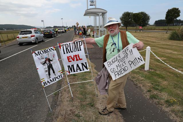 <p>Protesters gather on the A719 near Turnberry, where President Trump and first lady Melania Trump are spending the weekend at the Trump Turnberry resort in South Ayrshire, Scotland. (Photo: Andrew Milligan/PA Images via Getty Images) </p>