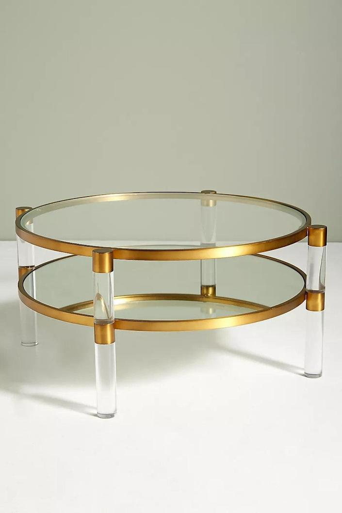 """$898, Anthropologie. <a href=""""https://www.anthropologie.com/shop/oscarine-lucite-round-mirrored-coffee-table"""" rel=""""nofollow noopener"""" target=""""_blank"""" data-ylk=""""slk:Get it now!"""" class=""""link rapid-noclick-resp"""">Get it now!</a>"""