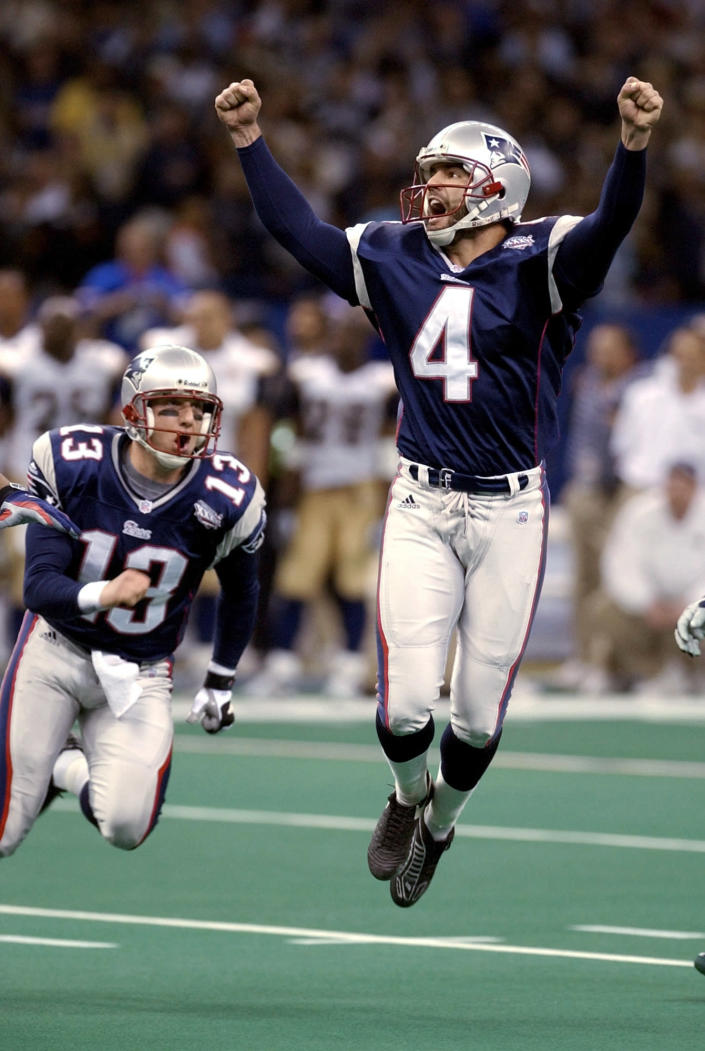 """FILE - In this Feb. 3, 2002, file photo, New England Patriots kicker Adam Vinatieri celebrates after kicking the 48-yard, game-winning field goal in the final seconds of NFL football's Super Bowl 36 against the St. Louis Rams in New Orleans. The 48-year-old former Indianapolis Colts and Patriots star told former teammate and SiriusXM radio host Pat McAfee that he plans to retire. """"By Friday, if paperwork goes in, you heard it here first,"""" Vinatieri said .(AP Photo/Amy Sancetta, File)"""