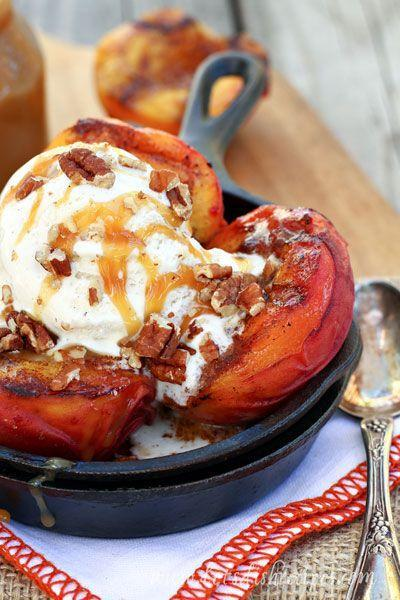 """<p>Nothing is better than vanilla ice cream melting over piping hot grilled peaches, drizzled in caramel sauce. </p><p><strong>Get the recipe at <a href=""""http://www.letsdishrecipes.com/2014/08/grilled-peaches-with-vanilla-ice-cream-and-salted-caramel-sauce.html"""" rel=""""nofollow noopener"""" target=""""_blank"""" data-ylk=""""slk:Let's Dish"""" class=""""link rapid-noclick-resp"""">Let's Dish</a>. </strong></p>"""