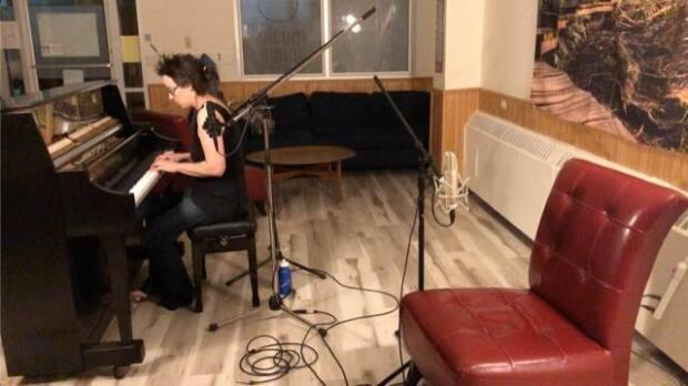 Carmen Braden plays piano in the Yellowknife Music Space. Braden has been using the space throughout the winter as her office and has composed new songs, recorded an album and even attended world premiers from there.