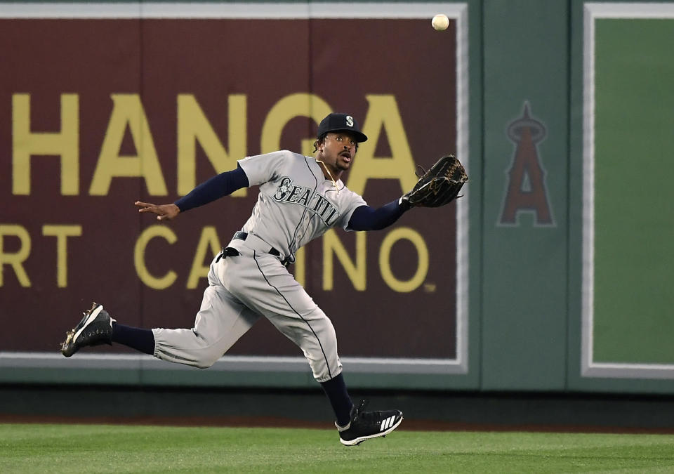Seattle Mariners center fielder Mallex Smith catches a ball hit by Los Angeles Angels' David Fletcher during the third inning of a baseball game Friday, June 7, 2019, in Anaheim, Calif. (AP Photo/Mark J. Terrill)