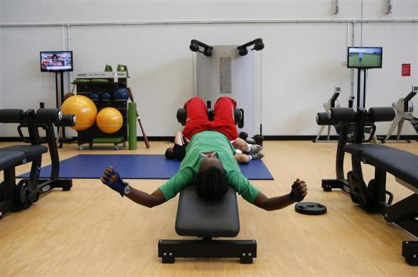 Swimmer Elsie Uwamahoro from Burundi, works out at the athletes village at the Olympic Park in London July 20, 2012.