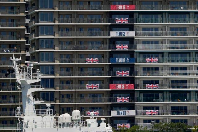 Flags and banners hang from Great Britain team apartments in the Olympic Village