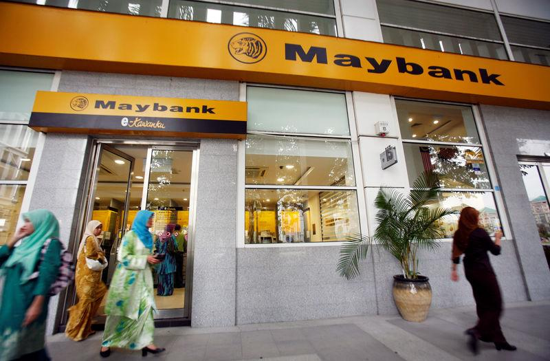 FILE PHOTO: Customers leave a branch of Malaysia's Maybank in Putrajaya