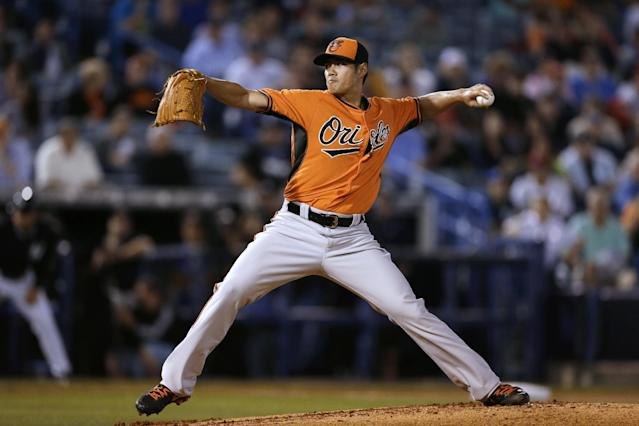 Baltimore Orioles starting pitcher Wei-Yin Chen throws a pitch during the first inning of an exhibition baseball game against the New York Yankees on Tuesday, March 4, 2014, in Tampa, Fla. (AP Photo/Charlie Neibergall)