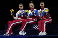 Gold medalists Russian Olympic committee Sabre team celebrate on the podium during the medal ceremony for the women's Sabre team final medal competition at the 2020 Summer Olympics, Saturday, July 31, 2021, in Chiba, Japan. (AP Photo/Hassan Ammar)