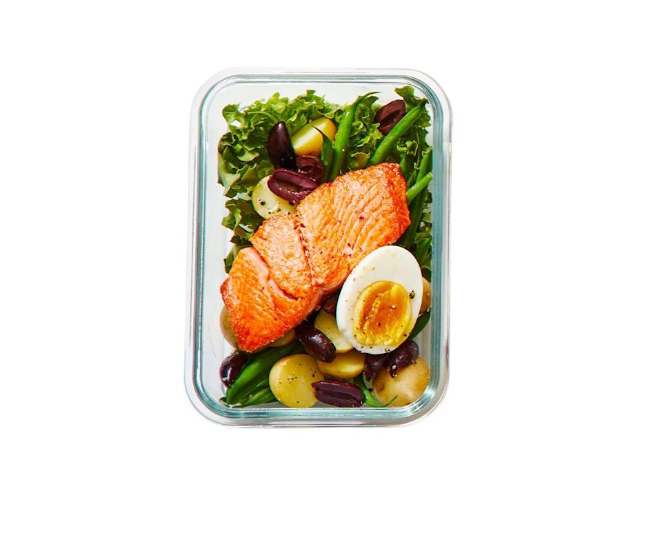 """<p>With olives, hard-boiled egg, potatoes and green beans, this is a great make-ahead lunch you can pack on the go.</p><p><em><a href=""""https://www.goodhousekeeping.com/food-recipes/a36558853/salmon-nicoise-salad-recipe/"""" rel=""""nofollow noopener"""" target=""""_blank"""" data-ylk=""""slk:Get the recipe for Salmon Niçoise Salad »"""" class=""""link rapid-noclick-resp"""">Get the recipe for Salmon Niçoise Salad »</a></em></p>"""