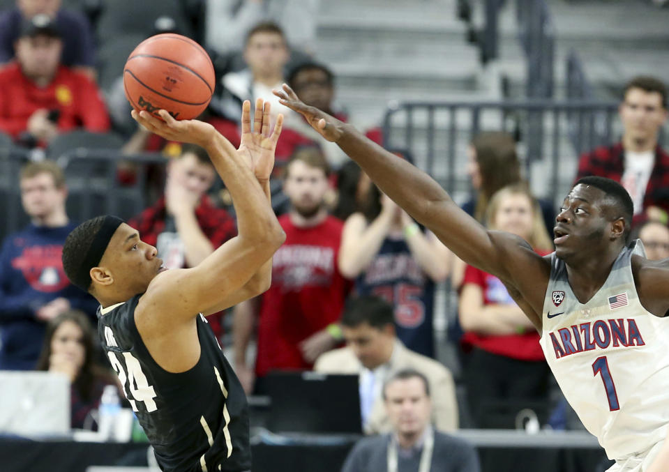 Colorado's George King, left, shoots while covered by Arizona's Rawle Alkins during the first half of an NCAA college basketball game in the quarterfinals of the Pac-12 men's tournament Thursday, March 8, 2018, in Las Vegas. (AP Photo/Isaac Brekken)
