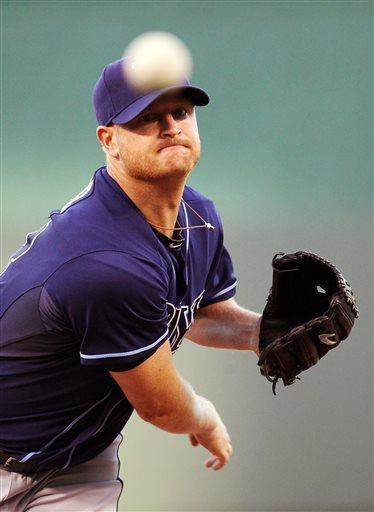 Tampa Bay Rays starting pitcher Alex Cobb (53) warms up at the pitcher's mound before the first inning of a baseball game against the Kansas City Royals at Kauffman Stadium in Kansas City, Mo., Tuesday, April 30, 2013. (AP Photo/Colin E. Braley)