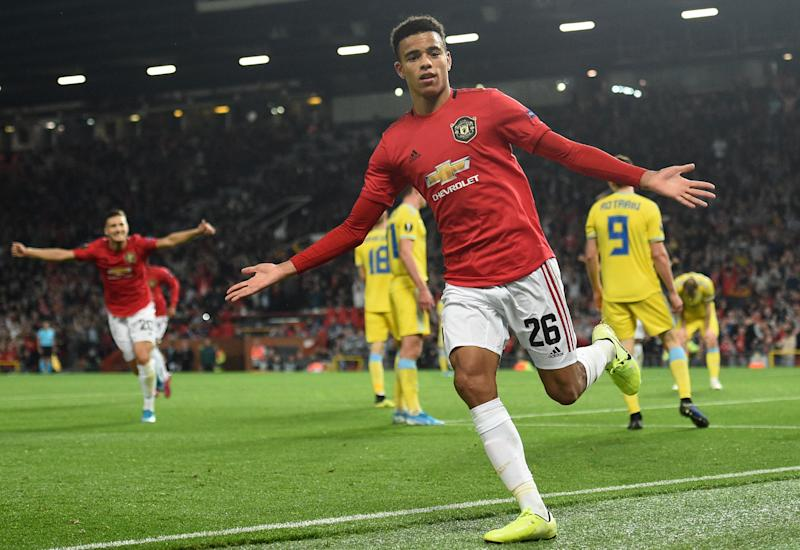 Manchester United's striker Mason Greenwood celebrates after scoring the opening goal of the UEFA Europa League Group L football match between Manchester United and Astana at Old Trafford in Manchester, north west England, on September 19, 2019. (Photo by Oli SCARFF / AFP) (Photo credit should read OLI SCARFF/AFP/Getty Images)