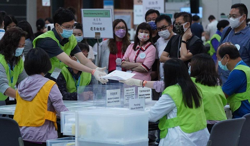 Ballot papers are separated into the relevant subsectors. Photo: Sam Tsang