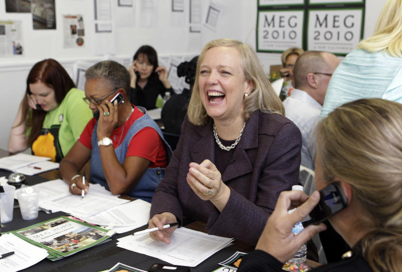 Meg Whitman, Republican candidate for California governor, laughs as other campaign workers talk on the phone at a campaign office in Oakland, Calif., Tuesday, Oct. 19, 2010. Whitman is former CEO of eBay. (AP Photo/Paul Sakuma)