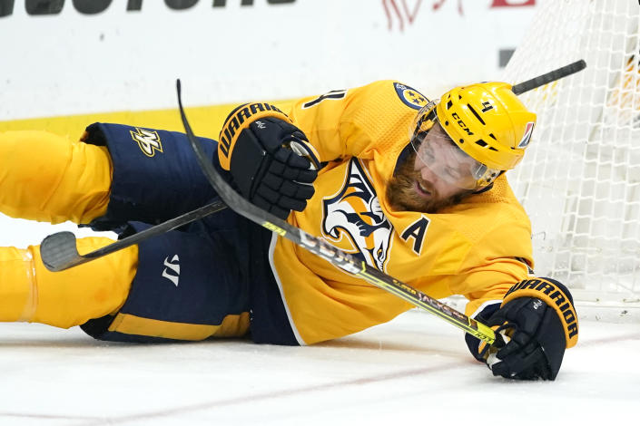 Nashville Predators defenseman Ryan Ellis (4) falls with his stick and the stick of an opponent in the third period of an NHL hockey game between the Nashville Predators and the Dallas Stars Saturday, May 1, 2021, in Nashville, Tenn. (AP Photo/Mark Humphrey)