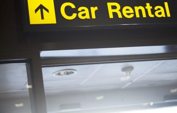 Car Rental sign seeming to point up