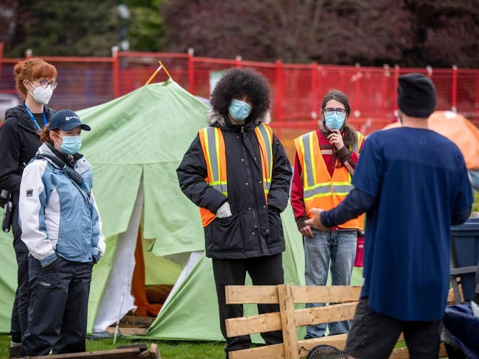 B.C. Housing and outreach workers speak with residents days before an injunction to clear their tent encampment at Strathcona Park in Vancouver, British Columbia on Tuesday, April 27, 2021.  (Ben Nelms/CBC - image credit)