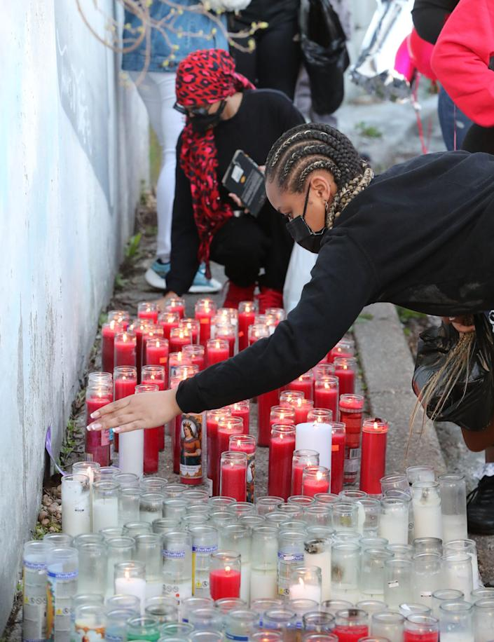 People place candles during a vigil for DMX where he grew up, on School Street in Yonkers April 13, 2021.