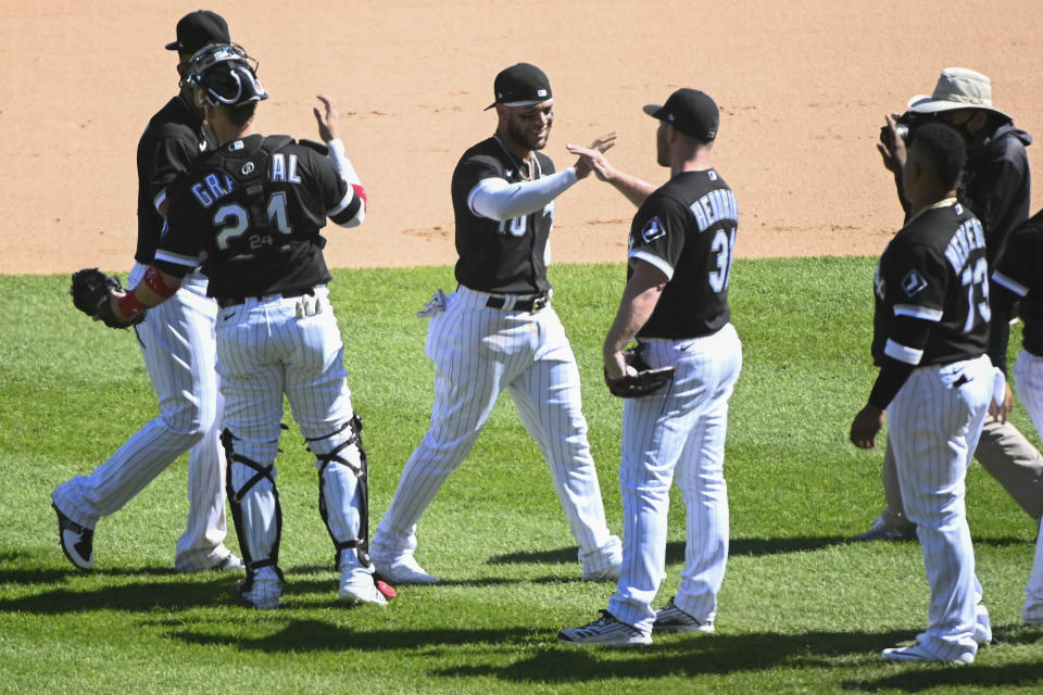 Chicago White Sox third baseman Yoan Moncada, third from left, celebrates with teammates at the end of the first baseball game of a doubleheader against the Baltimore Orioles, Saturday, May 29, 2021, in Chicago. (AP Photo/Matt Marton)