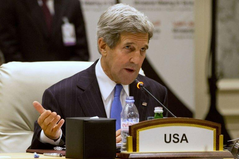 "US Secretary of State John Kerry addresses the ""Friends of Syria"" meeting in the Qatari capital Doha on June 22, 2013"