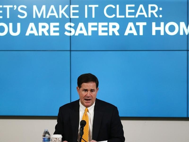 Arizona Republican Gov. Doug Ducey speaks about the latest coronavirus data at a news conference Thursday.