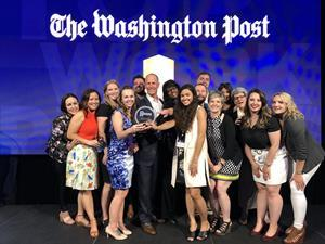 Thompson Creek employees flank CEO and President Rick Wuest in this photo from The Washington Post's 2019 celebration of Top Workplaces.