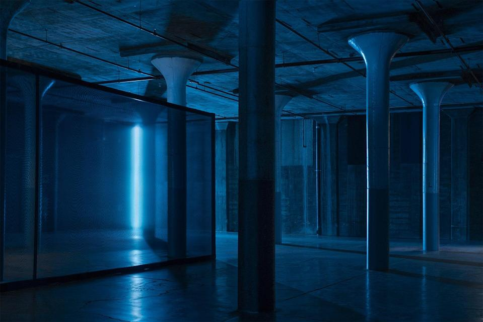 """On March 6 of last year, the Detroit DJ and artist Carl Craig took over the warehouse-like basement of Dia Beacon, a former Nabisco factory turned art mecca an hour's drive north of New York City. His long-planned sound installation, called <a href=""""https://www.diaart.org/exhibition/exhibitions-projects/carl-craig-partyafter-party-exhibition/"""" rel=""""nofollow noopener"""" target=""""_blank"""" data-ylk=""""slk:Party/After-Party"""" class=""""link rapid-noclick-resp""""><em>Party/After-Party</em></a><em>,</em> brought his familiar world (techno tracks, color-shifting lights) to an unfamiliar crowd: museumgoers better acquainted with the Flavins and Judds. The pandemic soon set in; Dia didn't reopen until late summer, this time with reserved tickets and lower headcounts. But the intimate overwhelm of <em>Party/After-Party</em> still turns up in full force—maybe fuller, given what a novelty it now is to feel bass rattling one's bones, to feel alone in company (even if it's just that one couple across the dark room). Craig designed mechanized shutters that flutter open partway through, recreating a sensation he once experienced upstairs at <a href=""""https://garage.vice.com/en_us/article/wxq3ew/party-on-at-dia-beacon"""" rel=""""nofollow noopener"""" target=""""_blank"""" data-ylk=""""slk:Berlin's Berghain"""" class=""""link rapid-noclick-resp"""">Berlin's Berghain</a>: the first rays of dawn streaking across the dance floor. The installation is extended till summer, when things might be waking up."""