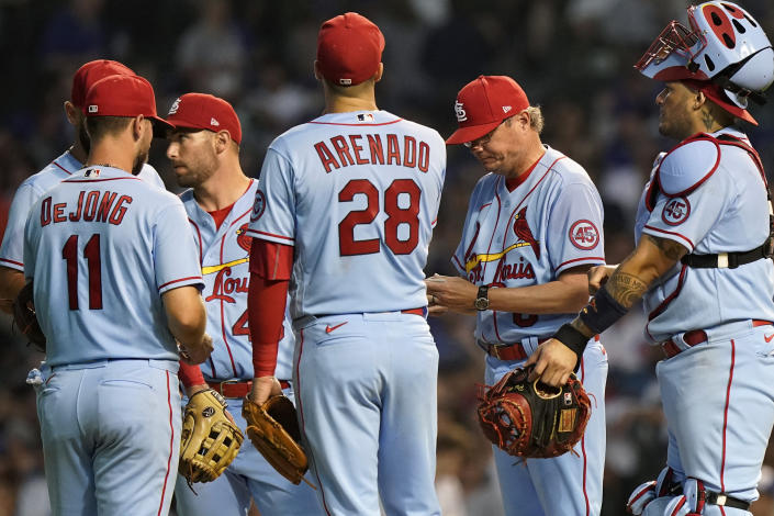 St. Louis Cardinals manager Mike Shildt, second from right, looks down while waiting for relief pitcher Junior Fernandez to arrive during the sixth inning of the team's baseball game against the Chicago Cubs in Chicago, Saturday, June 12, 2021. (AP Photo/Nam Y. Huh)