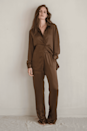 """<p>Since """"root beer"""" brown is <a href=""""https://www.popsugar.com/fashion/fall-color-trends-2021-48184237"""" class=""""link rapid-noclick-resp"""" rel=""""nofollow noopener"""" target=""""_blank"""" data-ylk=""""slk:a top color for fall"""">a top color for fall</a>, we're jumping on the bandwagon with this <span>Sundarbay Satin Relaxed Shirt</span> ($109).</p>"""