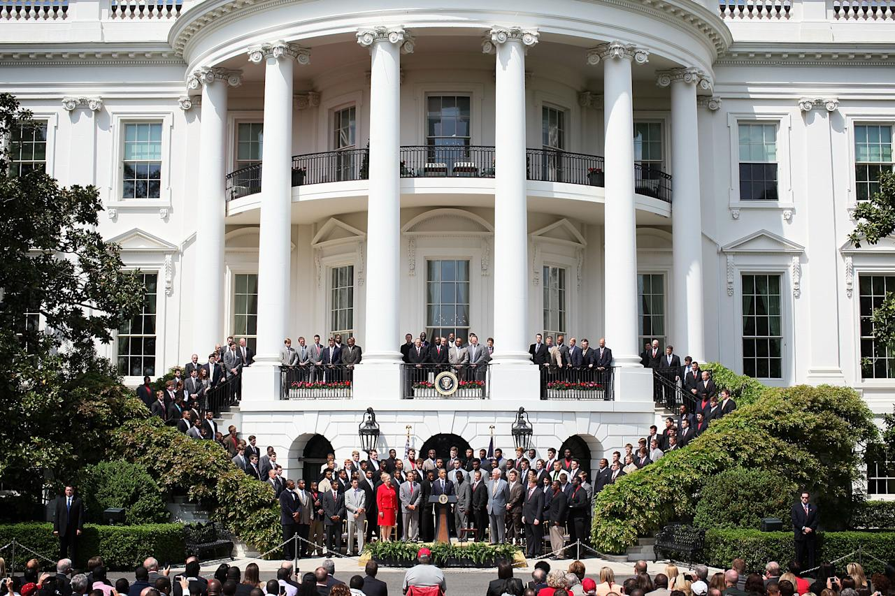 WASHINGTON, DC - APRIL 19:  U.S. President Barack Obama (C) hosts members of the University of Alabama Crimson Tide during a South Lawn event at the White House April 19, 2012 in Washington, DC. Obama hosted the BCS national champion to honor their win over the Louisiana State University Tigers.  (Photo by Alex Wong/Getty Images)