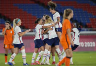 United States' players celebrate a goal scored by teammate Lynn Williams during a women's quarterfinal soccer match against Netherlands at the 2020 Summer Olympics, Friday, July 30, 2021, in Yokohama, Japan. (AP Photo/Silvia Izquierdo)