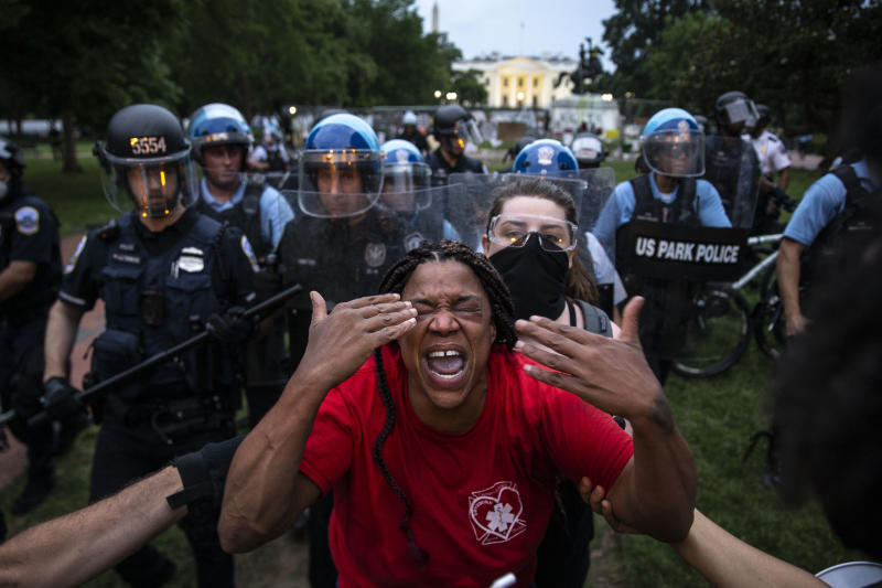 A woman reacts to being hit with pepper spray as protesters clash with U.S. Park Police after they attempted to pull down the statue of Andrew Jackson in Lafayette Square near the White House on June 22, 2020 in Washington, DC. (Tasos Katopodis /Getty Images)
