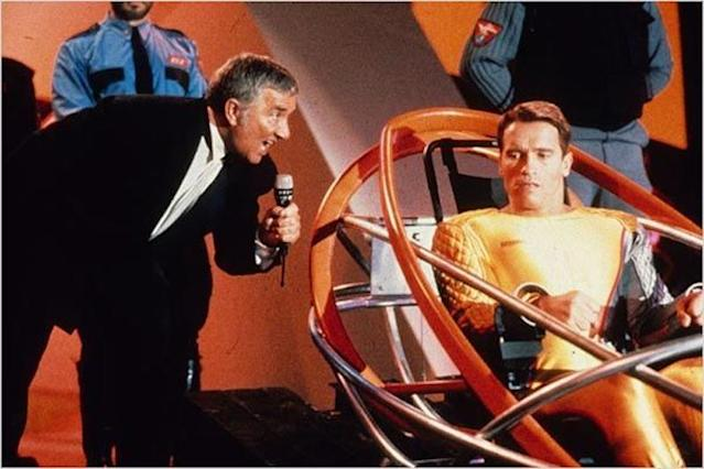 Arnold Schwarzenegger and Richard Dawson in <i>The Running Man</i> (Photo: TriStar Pictures)