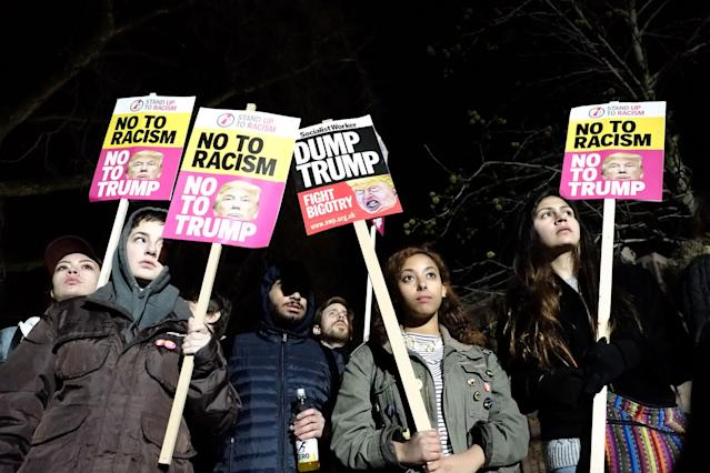 <p>JAN. 20, 2017 – Protesters holding placards attend a demonstration against U.S. President Donald J. Trump outside the United States Embassy in London, England. Mr Trump has become the 45th President of the United States following an inauguration ceremony in Washington, DC today. (Photo: Jay Shaw Baker/NurPhoto via Getty Images) </p>