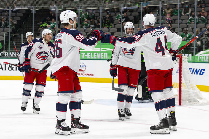 Columbus Blue Jackets defenseman Vladislav Gavrikov (44) is congratulated by teammate Jack Roslovic (96) after scoring a goal during the first period of an NHL hockey game against the Dallas Stars Saturday, April 17, 2021, in Dallas. (AP Photo/Sam Hodde)