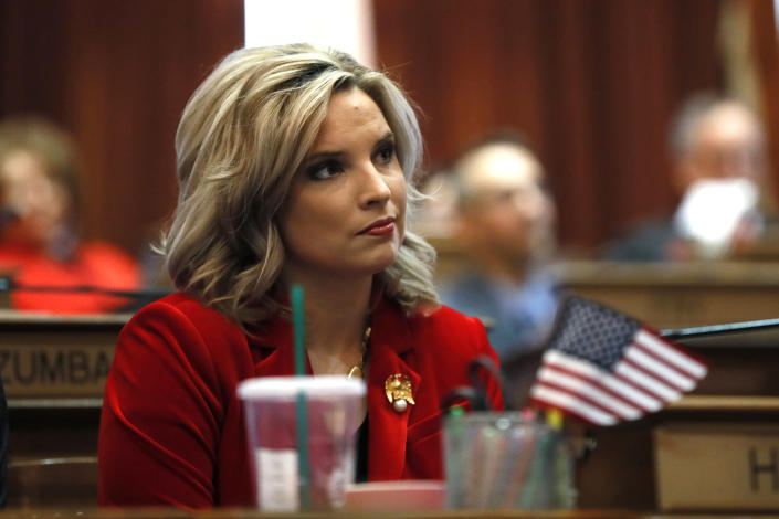 FILE - In this Jan. 13, 2020, file photo, State Rep. Ashley Hinson, R-Marion, watches as House Speaker Pat Grassley takes the oath of office during the opening day of the Iowa Legislature, at the Statehouse in Des Moines, Iowa. More Republican women than ever are seeking House seats this year after the 2018 election further diminished their limited ranks in Congress. But so far it appears that any gains this November could be modest. (AP Photo/Charlie Neibergall, File)