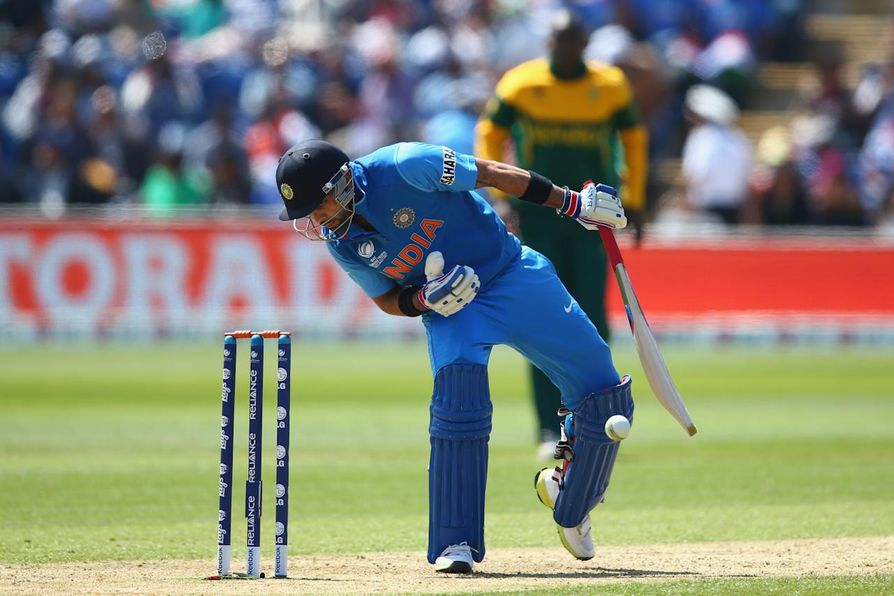 CARDIFF, WALES - JUNE 06:  Virat Kohli of India is hit by a delivery from Ryan McLaren of South Africa during the Group B ICC Champions Trophy match between India and South Africa at the SWALEC Stadium on June 6, 2013 in Cardiff, Wales.  (Photo by Michael Steele/Getty Images)