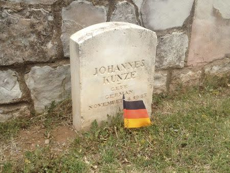 The tombstone of German soldier Johannes Kunze is seen at a cemetery for German and Italian prisoners of war at the Fort Reno Prisoners of War Cemetery in El Reno Oklahoma in this picture taken May 28, 2014. REUTERS/Heide Brandes